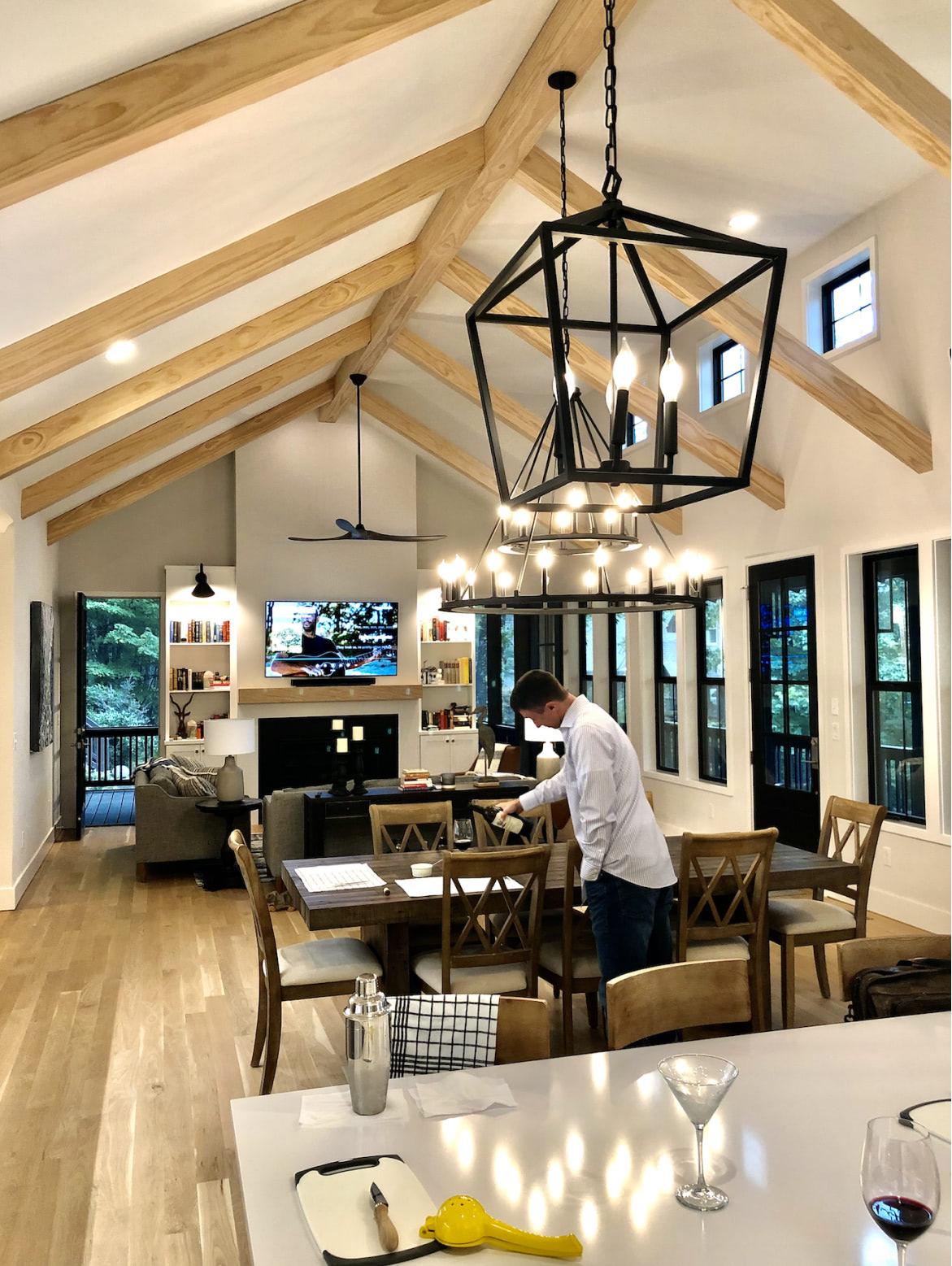 Lake Cove interior kitchen with person pouring wine