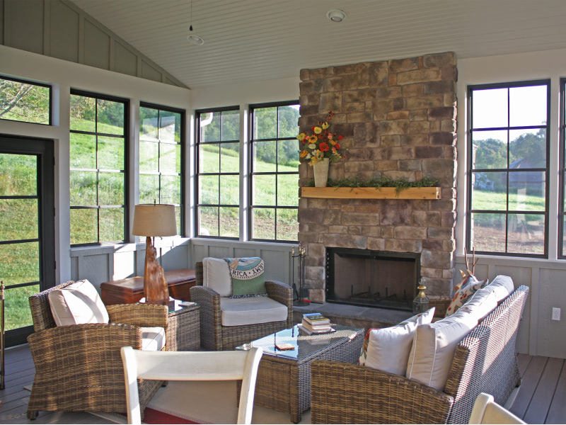 Upper 15 Home interior shot of sun room with fire place
